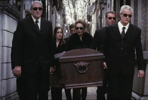 The guy in front doesn't even realise he's carrying a coffin