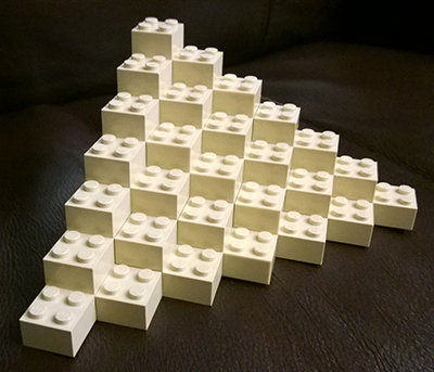 Q*bert's pyramid in LEGO, but you already knew that